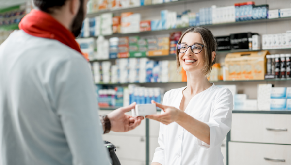 Pharmacists gives serialised medicine to a customer